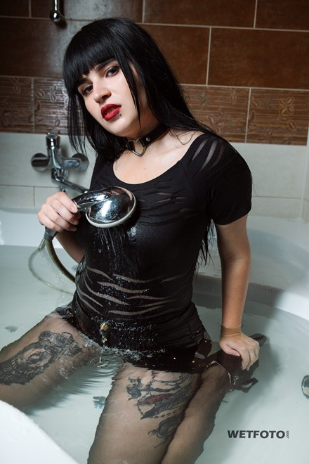 wetlook wet girl takes a bath shower clothes wearing wet black bodysuit tattoo jeans shorts nylons shoes wetfoto