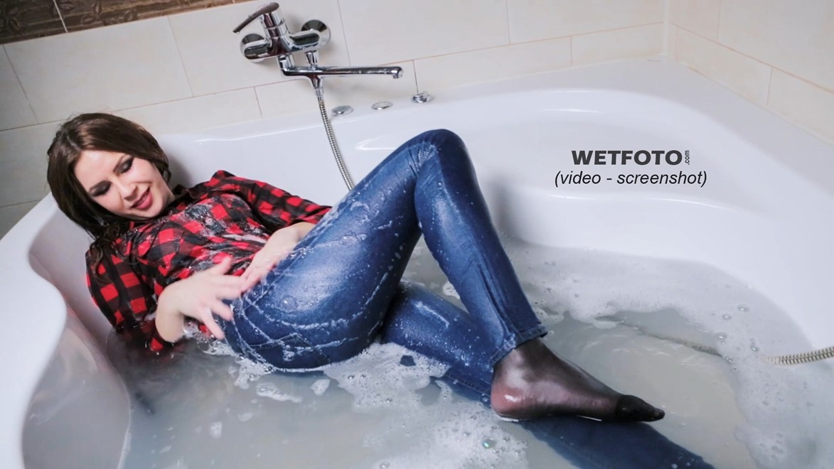 wet girl fully clothed jeans shirt jacket leather high heels boots wet hair bath