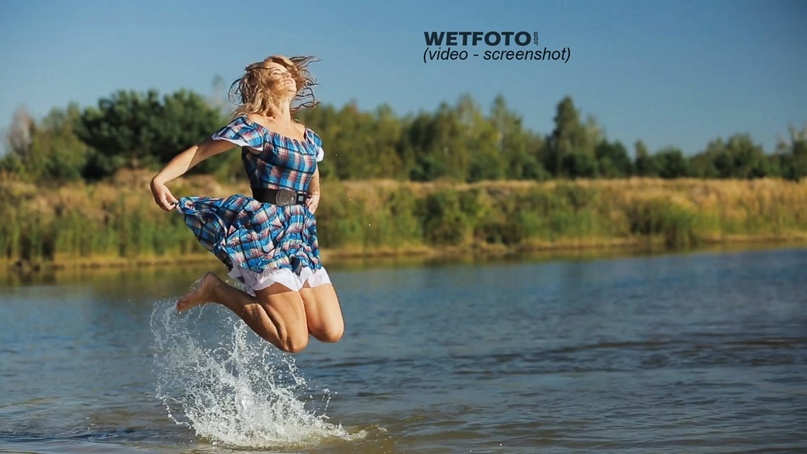 wet girl fully clothed dress shoes swim wet hair water lake