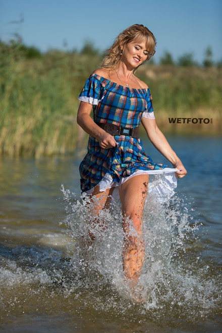 wetlook girl in wet dress