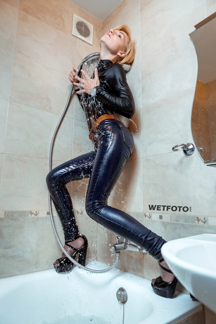 wet girl get wet golf jeans shoes high heels fully clothed wet hair shower