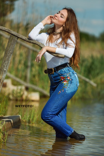 wetlook by gorgeous girl in wet tight jeans blouse and
