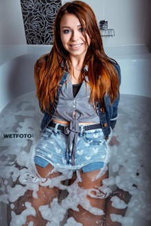 #408 - Wetlook by Sexy Girl in Fully Wet Jacket, Denim Shorts, Stockings and Sneakers in Shower