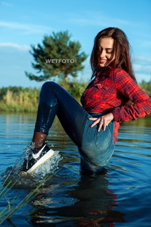 #426 - Wetlook by Brunette Girl in Soaking Wet Jeans, Shirt and Sneakers