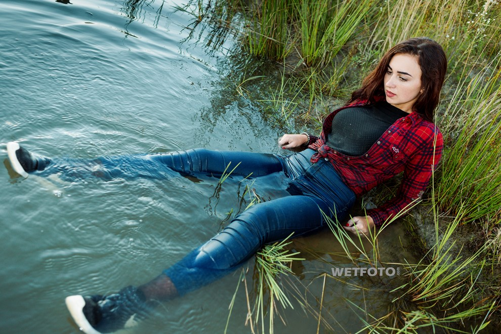wet girl get wet jeans t-shirt tights shirt sneakers fully soaked water bath swim