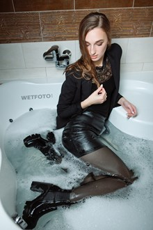 #428 - Fully Clothed Girl in Leather Skirt, Bodysuit, Pantyhose and Boots Get Wet in Milk Bath