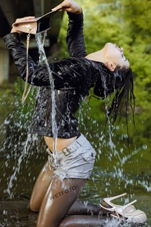 #431 - Flexible Fully Clothed Girl Dancing in the Water