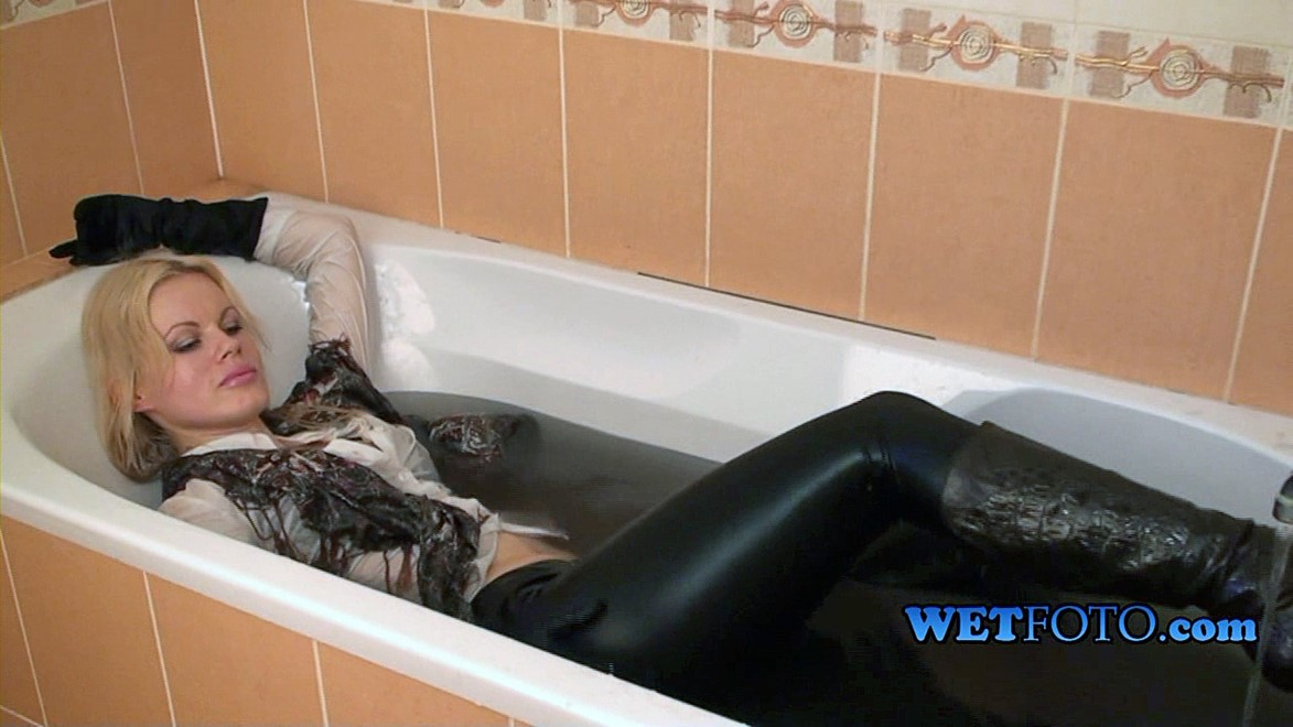 wet girl get wet wet hair fully clothed jacket leggings blouse socks scarf gloves leather boots heels bath