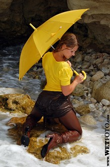 #50 - Wetlook by Bright Girl in Yellow Blouse, Skirt, Stockings and Boots at Sea