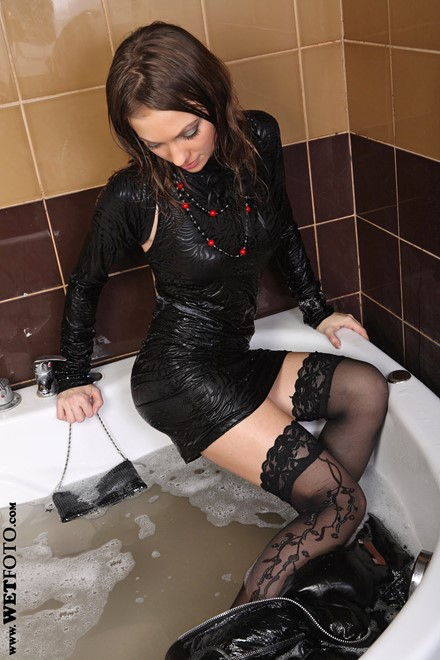 wet girl get wet wet hair fully clothed jacket leather dress stockings high heels bath