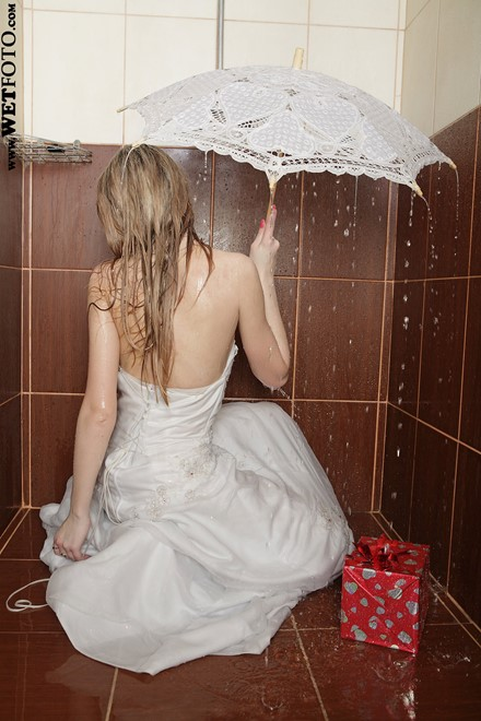 wet girl get wet wet hair fully clothed wedding dress stockings leather boots umbrella bath shower