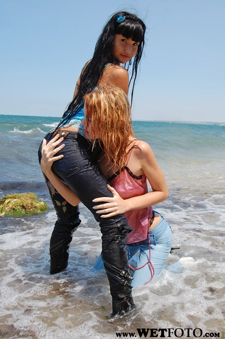 wet girl wet hair get wet swim fully clothed top jeans high heels leather boots fully soaked sea