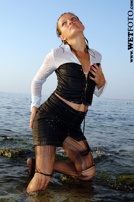 wet woman get wet wet hair fully clothed blouse skirt stockings high heels sea