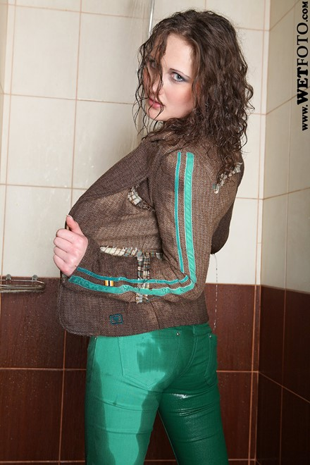 wet woman get wet wet hair fully clothed jacket t-shirt pants shoes shower