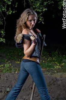 #75 - Dirty Wetlook by Wet Girl in Blue Jeans, Vest, T-Shirt and Socks in Mud