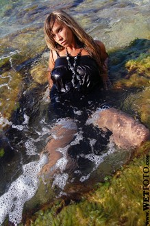 #8 - Wetlook by Girl in Tunic, Fishnet Tights and Leather Boots by the Sea