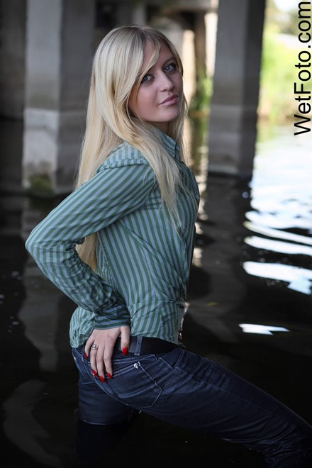 wet girl get wet wet hair fully clothed jeans shirt shoes river