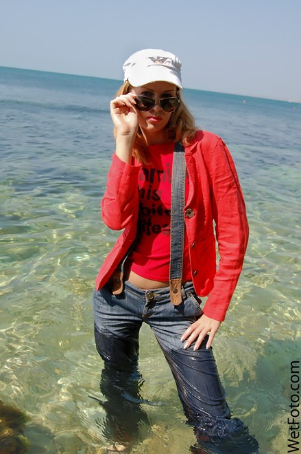 #113 - Wetlook by Cute Girl in Red Jacket, Jeans with Braces and Shoes