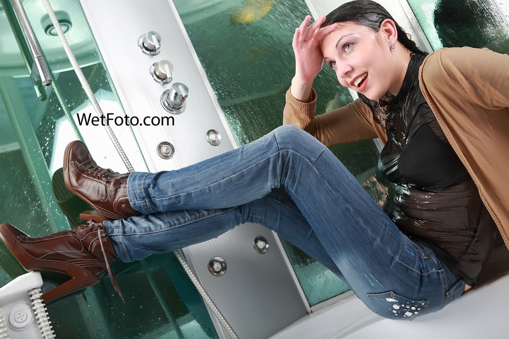 wet girl get wet wet hair fully clothed jeans jacket boots blouse jacuzzi
