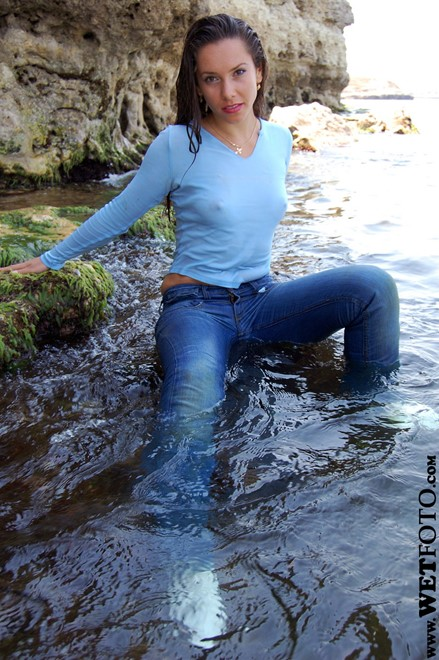 brunette wet girl get wet wet hair fully clothed blouse jeans high heels shoes leather sea