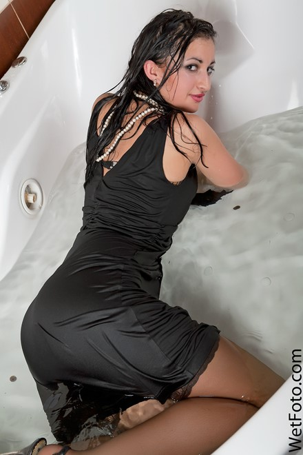 wet girl get wet wet hair fully clothed dress stockings high heels jacuzzi