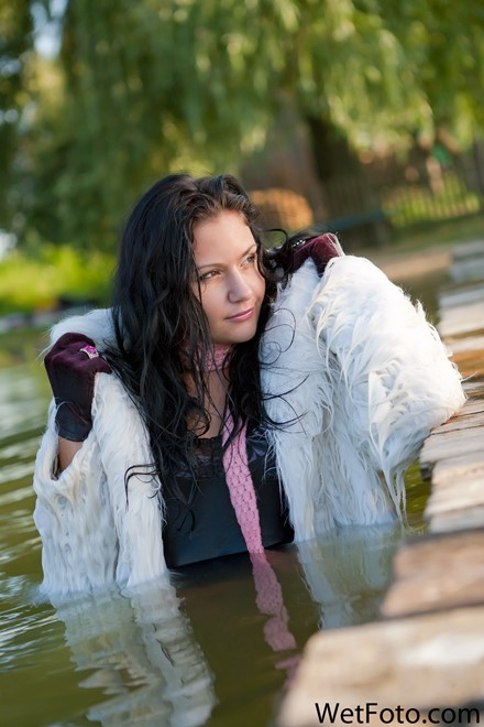 wet girl get wet wet hair swim fully clothed fur coat tight jeans t-shirt scarf shoes lake