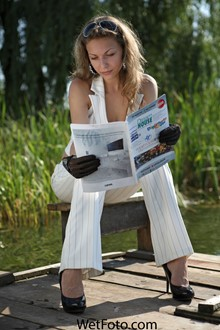 #136 - Total White Wetlook by Girl in Pants, Top and High Heels on Lake