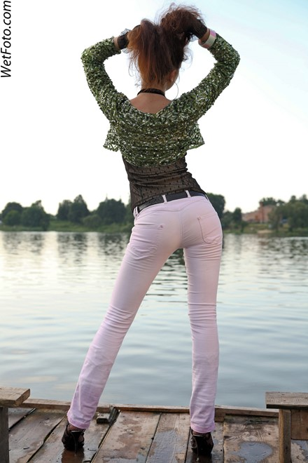 wet girl get wet wet hair swim fully clothed jacket top tight jeans evening gloves high heels lake