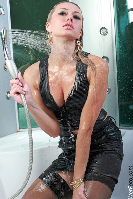 wet girl get wet wet hair fully clothed corset skirt stockings high heels shower bath