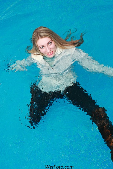 wet girl get wet swim fully clothed wet hair jacket tight jeans sweater boots high heels pool