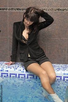 #163 - Wetlook by Brunette Girl in Black Jacket, Shorts, Sexy Stockings and Boots in Pool
