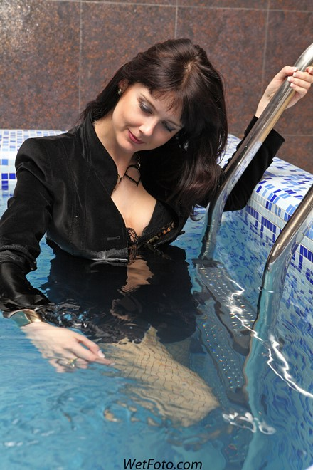 wet girl get wet fully clothed jacket shorts stockings sexy top boots poo