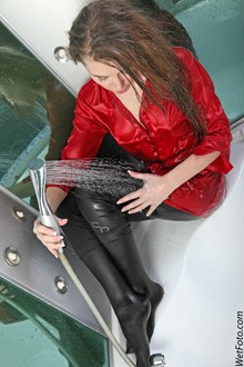 #165 - Wetlook by Long-Haired Girl in Red Coat, Leggings and Leather Gloves in Shower
