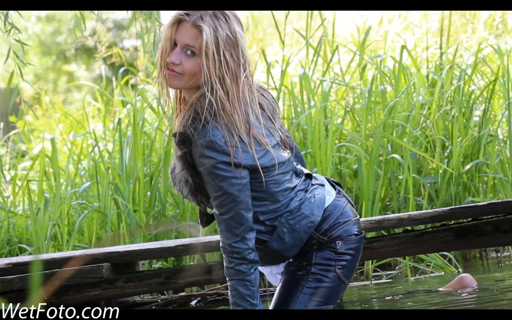 wet girl get wet wet hair swim fully clothed leather jacket fur jeans shirt high heels shoes lake