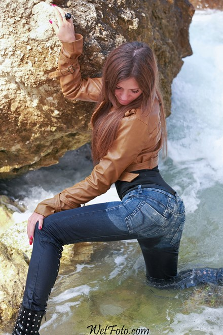 wet girl get wet wet hair swim fully clothed leather jacket tight jeans stockings high hells boots sea
