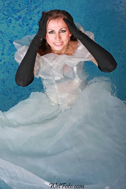 wet girl get wet wet hair fully clothed wedding dress bridal veil gloves leather high heels boots pool