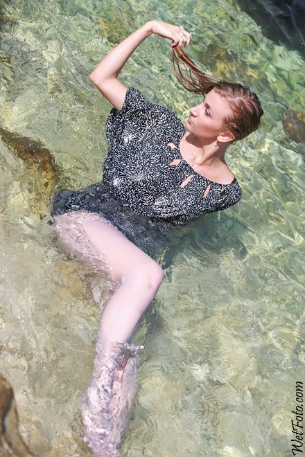 wet girl get wet wet hair swim fully clothed dress stockings shoes sea