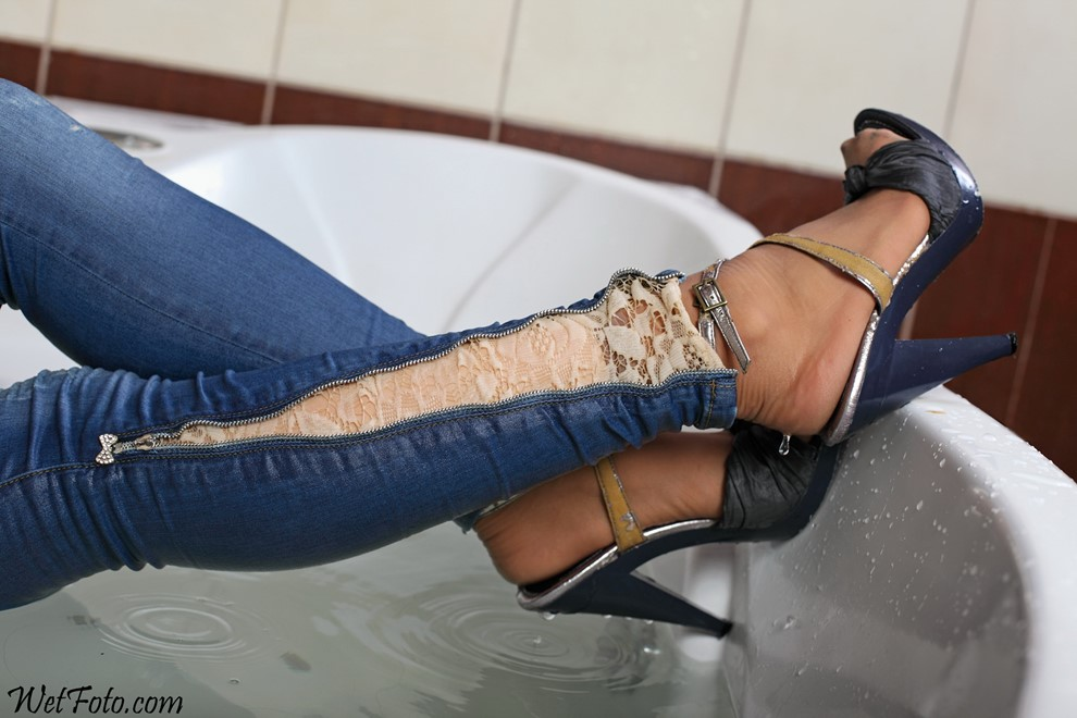 wet girl get wet wet hair fully clothed jacket tight jeans stockings t-shirt high heels jacuzzi shower