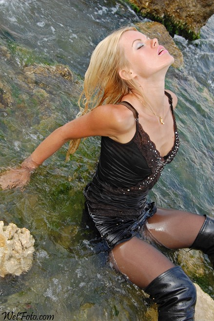 wet girl get wet fully clothed t-shirt mini skirt stockings leather jackboots sea