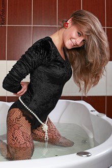 #194 - Hot Girl in Velour Jumpsuit and Fishnet Stockings Get Fully Wet in Bath