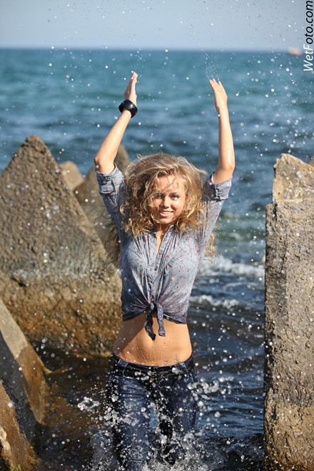 wet girl get wet wet hair swim fully clothed tight jeans shirt high heels sea