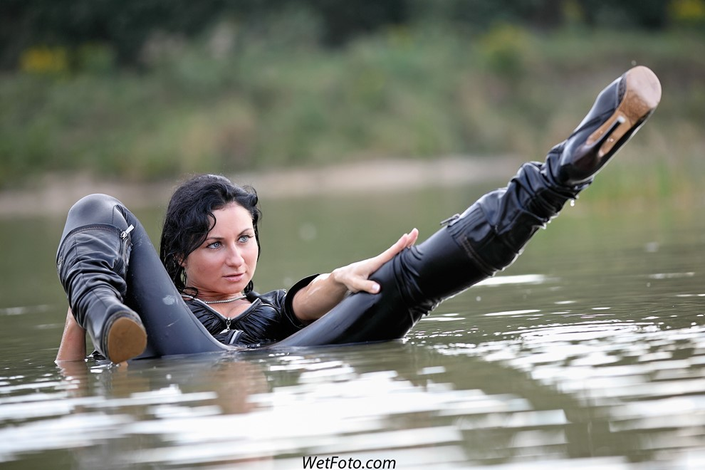 brunette wet girl wet hair get wet fully clothed corset leggings leather mantle high heels boots lake