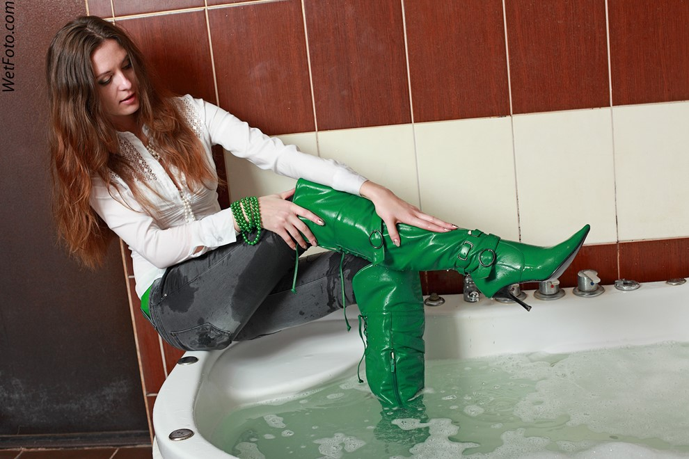 wet girl get wet wet hair blouse tight jeans jackboots leather jacuzzi bath