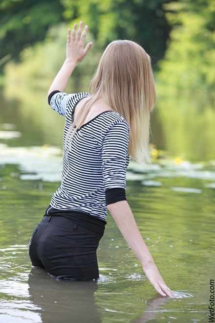 wet girl get wet wet hair fully clothed leggings tights blouse high heels lake