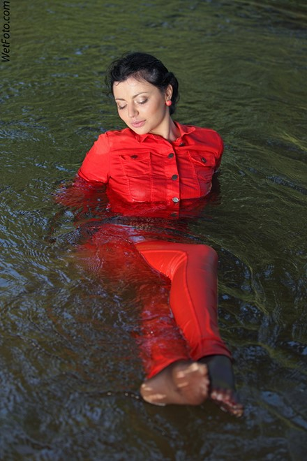 wet girl get wet swim fully clothed wet hair jacket blouse tight pants tights high heels lake