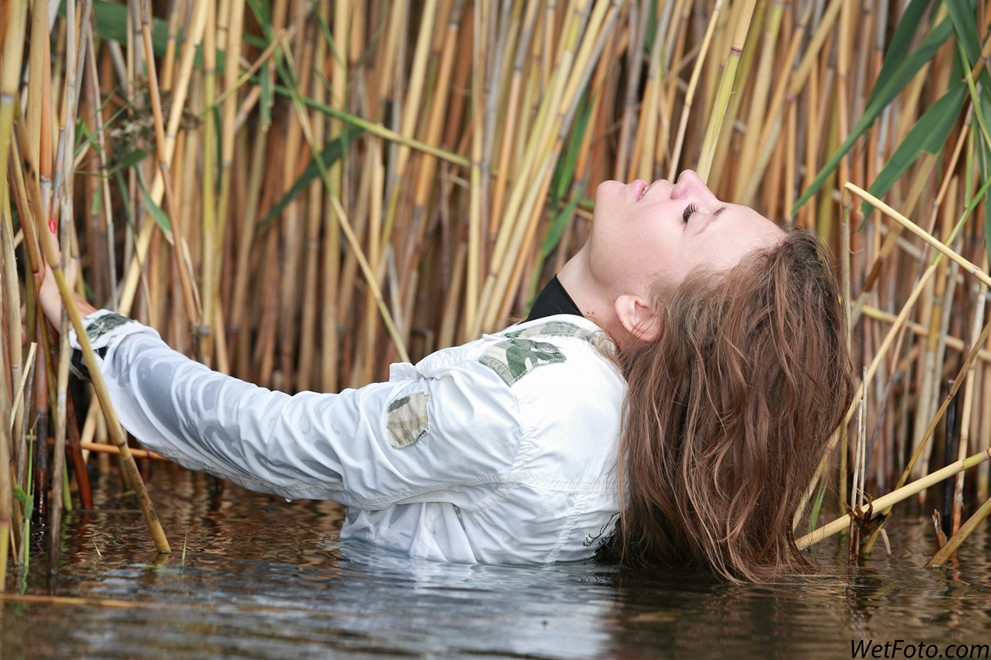 wet girl get wet wet hair soaking wet jacket golf leather pants high heels lake