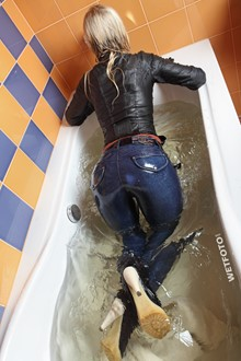 #227 - Wetlook by Hot Girl in Leather Jacket, Tight Jeans, Gloves and High Heels in Bath