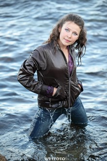 #235 - Wetlook by Beautiful Girl in Jacket and Tight Jeans on Sea