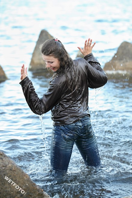 wet girl get wet swim fully clothed wet hair jacket shirt jeans sea
