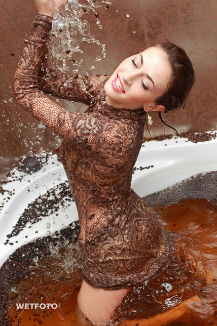 wet girl get wet wet hair fully clothed dress high heels bath